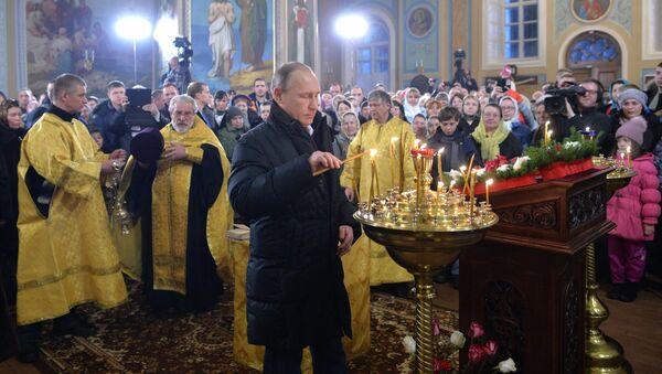 Tổng thống Vladimir Putin trong buổi lễ trọng Giáng sinh - Sputnik Việt Nam