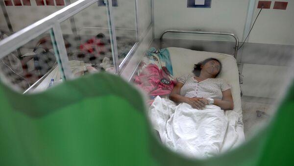 Người phụ nữ tại bệnh viện ở San Salvador - Sputnik Việt Nam