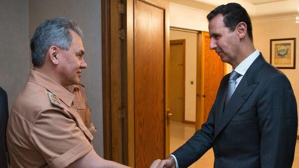 Bộ trưởng Quốc phòng Nga Sergei Shoigu và Tổng thống Syria Bashar al-Assad - Sputnik Việt Nam