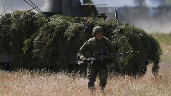 In this Tuesday June 17, 2014 file photo, soldiers from NATO countries practice during a military exercise 'Saber Strike 2014' at the Rukla military base some 120 kms (75 miles) west of the capital Vilnius, Lithuania. - Sputnik Việt Nam