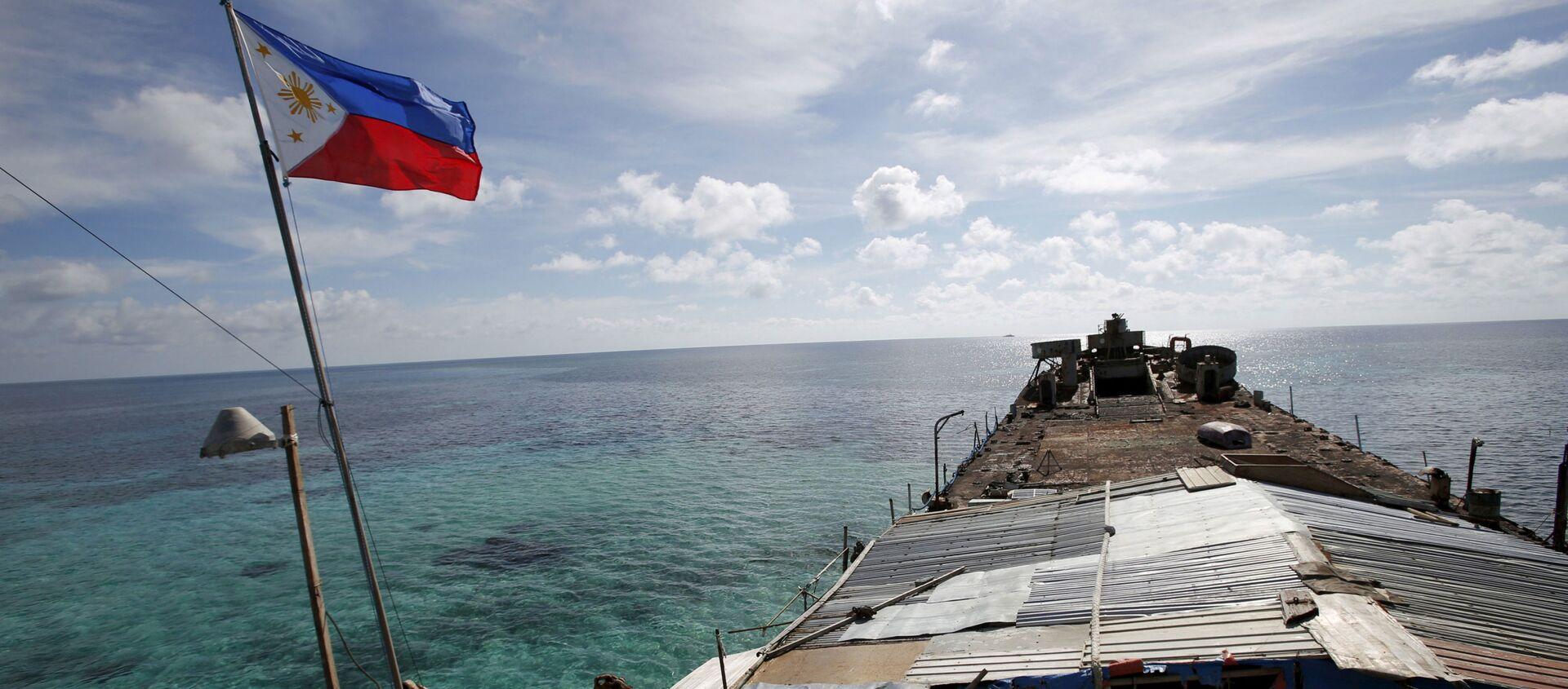 Lá cờ Philippines trên con tàu ở Biển Đông - Sputnik Việt Nam, 1920, 25.03.2021
