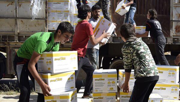 Phân phối viện trợ nhân đạo Nga cho người dân Syria - Sputnik Việt Nam