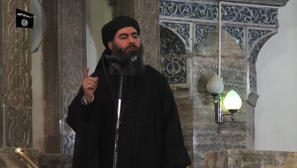 This July 5, 2014 photo shows an image grab taken from a propaganda video released by al-Furqan Media allegedly showing the leader of the Islamic State (IS) jihadist group, Abu Bakr al-Baghdadi, aka Caliph Ibrahim, adressing Muslim worshippers at a mosque in the militant-held northern Iraqi city of Mosul - Sputnik Việt Nam