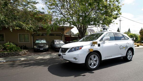Google's self-driving Lexus car drives along street during a demonstration at Google campus on Wednesday, May 13, 2015, in Mountain View, Calif - Sputnik Việt Nam