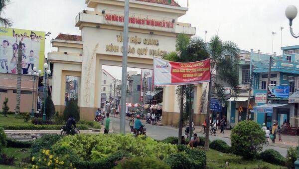Cổng chào Hậu Giang đoạn qua thị trấn Cái Tắc, Chau Thành A - Sputnik Việt Nam