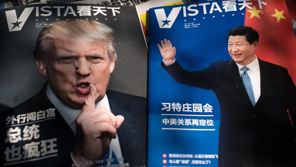 Magazines featuring front pages of US President Donald Trump (L) and China's President Xi Jinping (R) are displayed at a news stand in Beijing - Sputnik Việt Nam