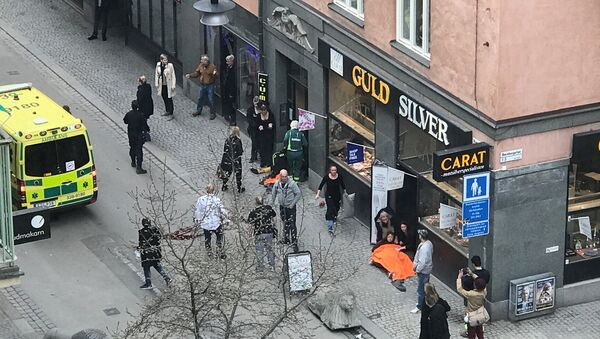 Ambulance in a street near the site were a truck was driven into a crowd in central Stockholm, Sweden - Sputnik Việt Nam