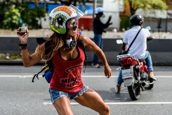 Ngày Lao động Quốc tế 1 tháng Năm  ở Venezuela. Các thành viên tham gia biểu tình chống Chính phủ tại thủ đô Caracas. - Sputnik Việt Nam