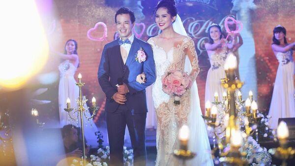 Cặp đôi trai tài gái sắc Việt Anh - Lê Sang trong ngày trọng đại nhất cuộc đời. - Sputnik Việt Nam