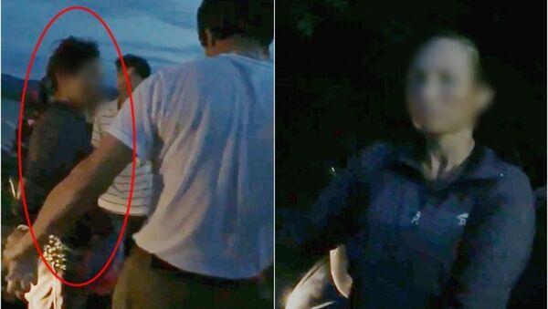 Người dân vây bắt người phụ nữ nghi có hành vi bắt cóc trẻ em. - Sputnik Việt Nam