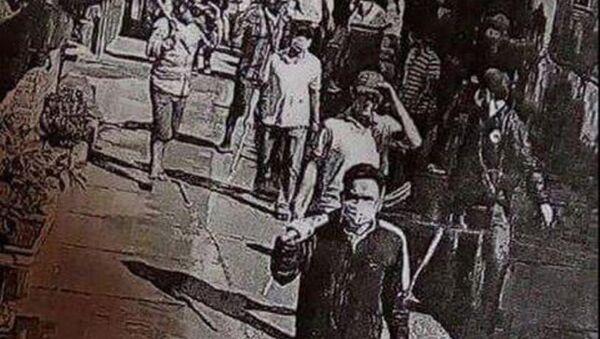 Hình ảnh nhóm côn đồ được camara ghi lại.  - Sputnik Việt Nam