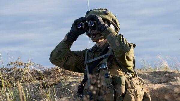 Солдат во время учений НАТО Saber Strike. Архивное фото - Sputnik Việt Nam