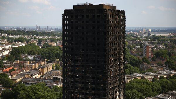 The burnt out remains of the Grenfell apartment tower are seen in North Kensington, London, Britain, June 18, 2017. - Sputnik Việt Nam