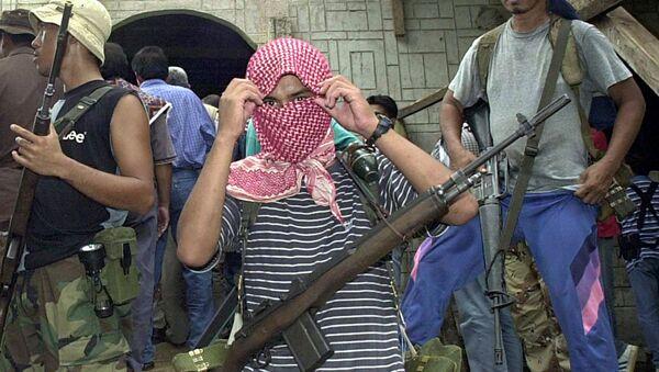 Боевики из филиппинской воинственной террористической исламистской группы Абу Сайяф. Архивное фото - Sputnik Việt Nam