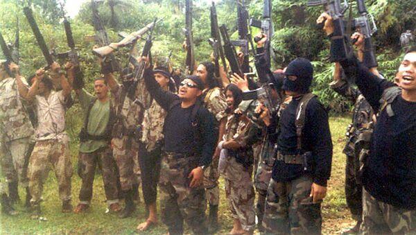Боевики филиппинской воинственной террористической исламистской группы Абу Сайяф. Архивное фото - Sputnik Việt Nam