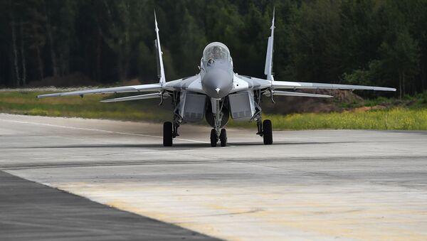 Многоцелевой истребитель МиГ-29 во время испытаний на полигоне АО Российская самолетостроительная Корпорация МиГ в Московской области - Sputnik Việt Nam