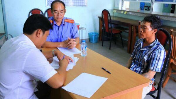 Nghi can Sang khi bị bắt giữ tại cơ quan công an - Sputnik Việt Nam