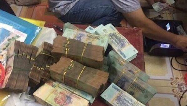 Một phần tang vật được cơ quan Cảnh sát điều tra thu giữ. - Sputnik Việt Nam
