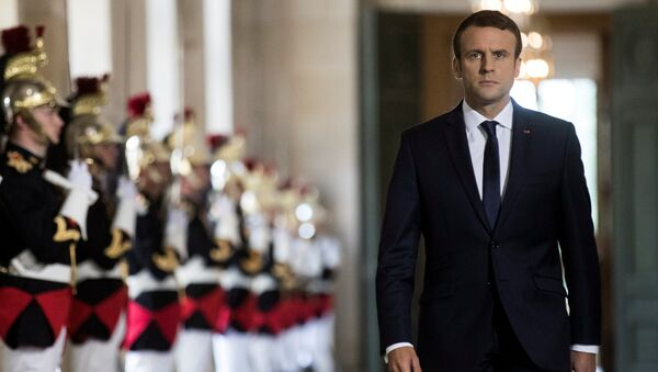 French President Emmanuel Macron walks through the Galerie des Bustes (Busts Gallery) to access the Versailles Palace's hemicycle for a special congress gathering both houses of parliament (National Assembly and Senate), near Paris, France, July 3, 2017. - Sputnik Việt Nam