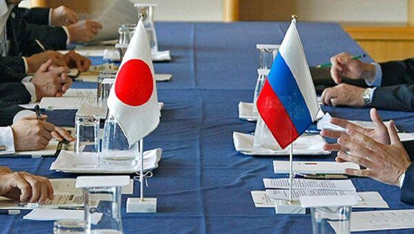 Quốc kỳ Nhật Bản và Nga - Sputnik Việt Nam