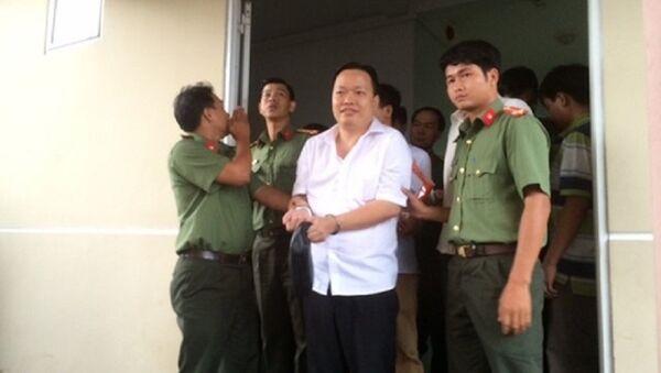 Nguyễn Huỳnh Đạt Nhân , giám đốc Công ty Tây Nam khi bị bắt giữ. - Sputnik Việt Nam