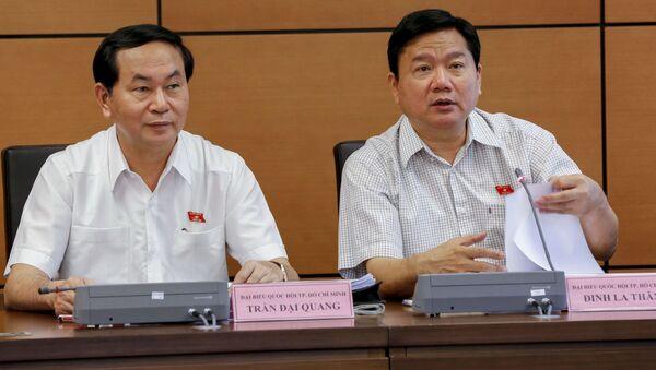Chủ tịch nước Trần Đại Quang  và Đinh La Thăng - Sputnik Việt Nam