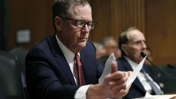 FILE - In this Tuesday, March 14, 2017, file photo, United States Trade Representative-nominee Robert Lighthizer, foreground, looks at documents during his confirmation hearing on Capitol Hill in Washington - Sputnik Việt Nam