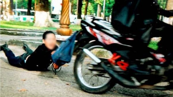 Người dân truy đuổi, bắt gọn tên cướp giật túi xách người đi đường - Sputnik Việt Nam