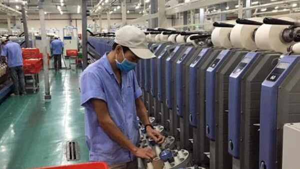 Sản xuất sợi xuất khẩu tại Công ty Cổ phần Sợi Phú Mai - Khu công nghiệp Phú Bài Huế. - Sputnik Việt Nam