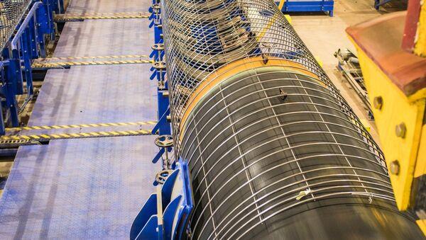 Нанесение бетонного покрытия на трубы для Северного потока ‑ 2 на заводе Wasco в Котке, Финляндия - Sputnik Việt Nam