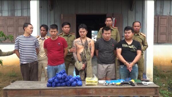 5 đối tượng mang vũ khí nóng vận chuyển 50 nghìn viên ma túy - Sputnik Việt Nam