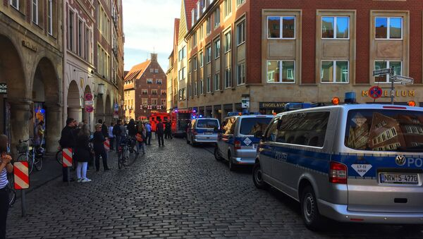 First responders work at the scene when several people were killed and injured when a car ploughed into pedestrians in Muenster, western Germany on April 7, 2018 - Sputnik Việt Nam