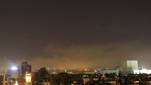 Damascus skies erupt with anti-aircraft fire and smoke as the U.S. launches an attack on Syria targeting different parts of the Syrian capital Damascus, early Saturday, April 14, 2018 - Sputnik Việt Nam