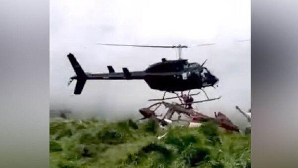 Sốc: Cánh quạt của chiếc trực tăng cắt đứt người kỹ sư trong khi hạ cánh (Video) - Sputnik Việt Nam