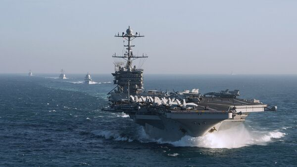The aircraft carrier group of the United States Navy led by USS Harry S. Truman, front, and a ship escort are seen leaving the port of Norfolk heading for the Middle East - Sputnik Việt Nam