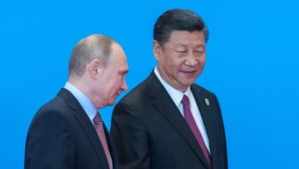 May 15, 2017. Russian President Vladimir Putin and Chinese President Xi Jinping, right, during the welcome ceremony for the heads of the delegations participating in the Belt and Road Forum, at the Yanqi Lake International Convention Center. - Sputnik Việt Nam