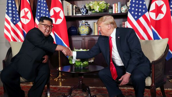 U.S. President Donald Trump shakes hands with North Korea's leader Kim Jong Un before their bilateral meeting at the Capella Hotel on Sentosa island in Singapore June 12, 2018. - Sputnik Việt Nam