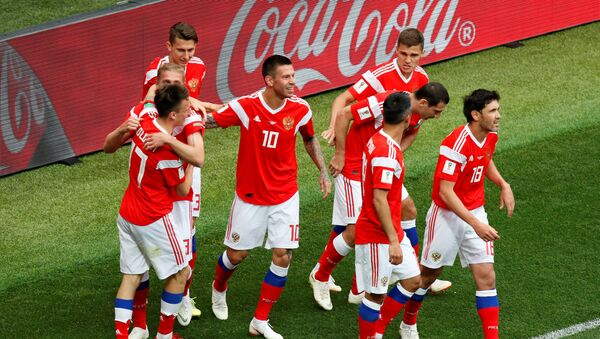 Soccer Football - World Cup - Group A - Russia vs Saudi Arabia - Luzhniki Stadium, Moscow, Russia - June 14, 2018 Russia's Yury Gazinsky celebrates scoring their first goal with team mates - Sputnik Việt Nam