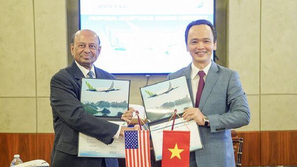 Chủ tịch Tập đoàn FLC Trịnh Văn Quyết và Phó Chủ tịch Boeing Dinesh Keskar thực hiện lễ ký kết. - Sputnik Việt Nam