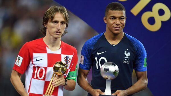 Tiền vệ đội tuyển quốc gia Croatia, Luka Modrić và tiền đạo đội Pháp Kylian Mbappé. - Sputnik Việt Nam