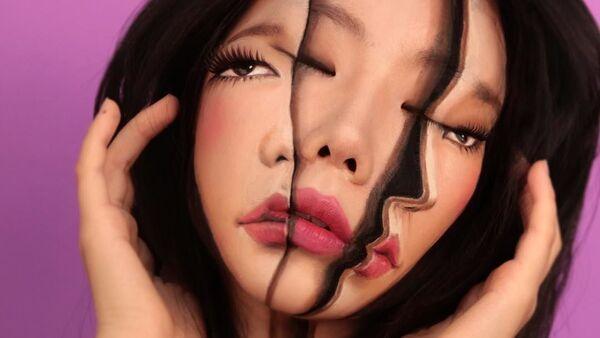 Nghệ sĩ Hàn Quốc Dane Yun, người vẽ ảo tưởng trên cơ thể của mình. - Sputnik Việt Nam