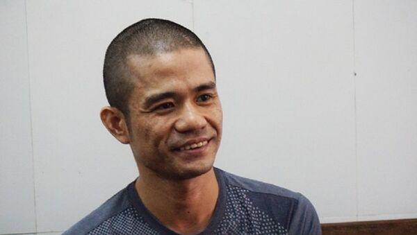 Đối tượng Lê Ngọc Sơn tại cơ quan cảnh sát điều tra Công an TP Vinh sáng 2/10. - Sputnik Việt Nam