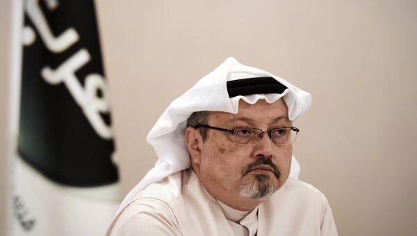 In this file photo taken on December 15, 2014, general manager of Alarab TV, Jamal Khashoggi, looks on during a press conference in the Bahraini capital Manama. - Sputnik Việt Nam