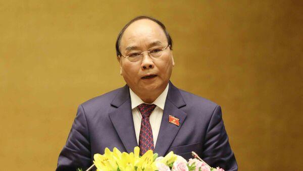 Thủ tướng Chính phủ Nguyễn Xuân Phúc trình bày Báo cáo về tình hình kinh tế - xã hội năm 2018 và kế hoạch phát triển kinh tế - xã hội năm 2019. - Sputnik Việt Nam