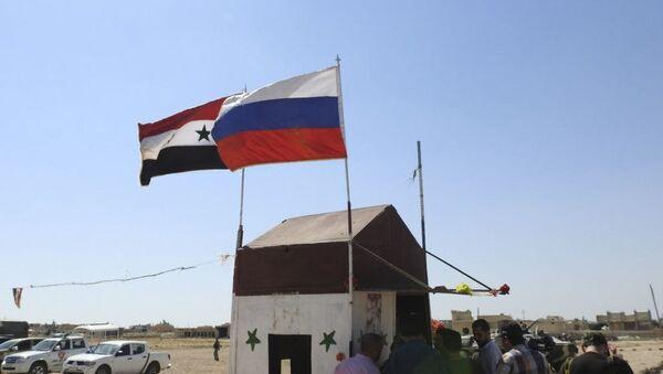 Quốc kỳ LB Nga và Syria - Sputnik Việt Nam
