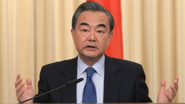 Foreign Minister of the People's Republic of China Wang Yi during a joint press conference with Russian Foreign Minister Sergey Lavrov on the results of their meeting in Moscow - Sputnik Việt Nam