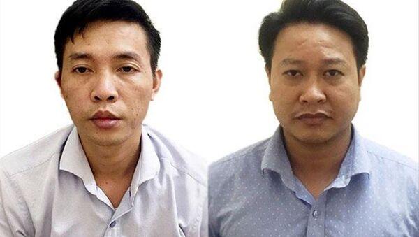 Hai bị can Đỗ Mạnh Tuấn và Nguyễn Khắc Tuấn trực tiếp sửa bài thi - Sputnik Việt Nam