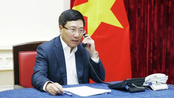 Phó Thủ tướng, Bộ trưởng Ngoại giao Phạm Bình Minh điện đàm với Bộ trưởng Ngoại giao Malaysia. - Sputnik Việt Nam