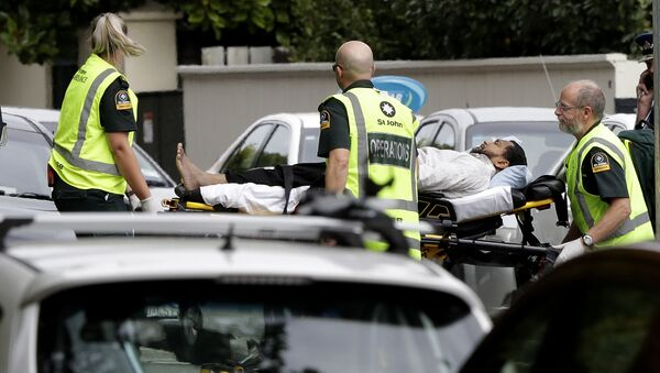 Ambulance staff take a man from outside a mosque in central Christchurch, New Zealand, Friday, - Sputnik Việt Nam