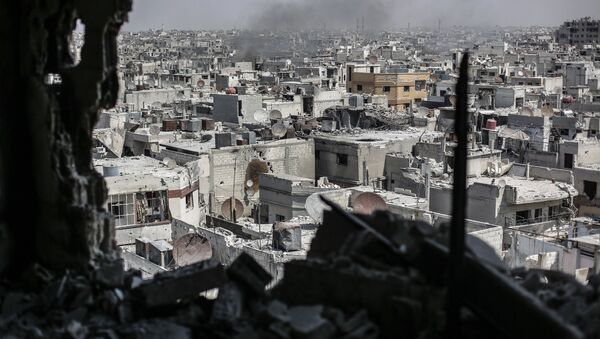 Tầm nhìn từ một tòa nhà cao tầng xuống những đường phố ở trung tâm Homs - Sputnik Việt Nam